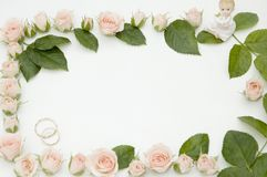 Frame for wedding photo. Made from roses royalty free stock image