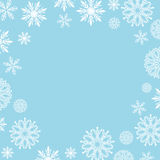 Frame of white elegant snowflakes for Christmas and New year, with place for text. Stock Photos