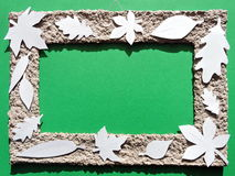 Frame with white leaves. Paper cutting. stock photography