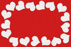 Frame of white paper hearts on red background Stock Photography