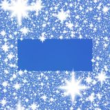 Frame from white snowflakes on a blue background royalty free stock photography