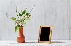 Frame on white table Royalty Free Stock Photos
