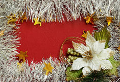 Frame of white tinsel and poinsettia Royalty Free Stock Photography