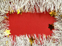 Frame of white tinsel on red background Royalty Free Stock Photo