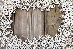 Frame of white wooden snowflakes Stock Photo