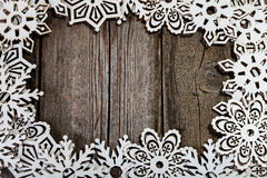 Frame white wooden snowflakes Royalty Free Stock Images