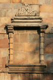 A frame of a window was sculptured on a wall at Qutb minar in New Delhi (India) Royalty Free Stock Image