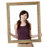 Frame with woman. Wooden frame with young woman, closeup portrait on white background royalty free stock photography