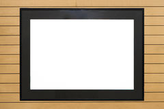 Frame. Black frame on wood background Stock Image