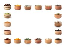 Frame of wooden bowls with different spices and herbs on white background. Large collection with space for design royalty free stock image