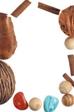 Frame of wooden decorations,cinnamon sticks,stones Stock Photo
