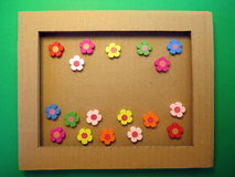 Frame and wooden flowers Stock Photos