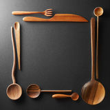 Frame of wooden spoons, forks and a knife Stock Images