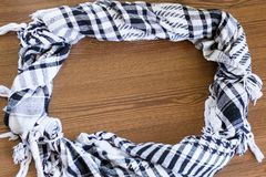 Frame from wool scarf. The keffiyeh is a gender-neutral black and white scarf that is usually worn around neck or head. Frame background texture, pattern. Scarf stock photo
