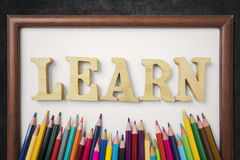 Frame and word of learn on the blackboard Stock Photography