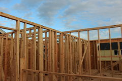 Frame work of wooden house. Frame of the upper story of a house under construction stock photo