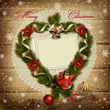 Frame with wreath of pine branches on snowy wooden background. Snowy wooden background with frame and a wreath of pine branches royalty free stock photos