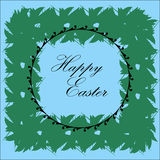Frame wreath with text. Frame green wreath with the text Happy Easter on a blue background Royalty Free Stock Images