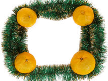 Frame of yellow tangerine on green garland Stock Photography