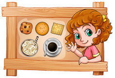 A frame with a young girl with drinks and biscuits Royalty Free Stock Image