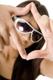 Framed 1. A young woman frames herself with fingers and thumbs Stock Photos