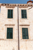 Framed ancient windows with green shutters Stock Image