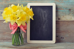 Framed blackboard with daffodils Royalty Free Stock Photo