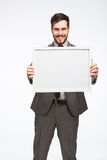 Framed board presented by a elegant man Stock Photos