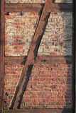Framed brick wall. Old brick wall framed in painted wood Royalty Free Stock Photos