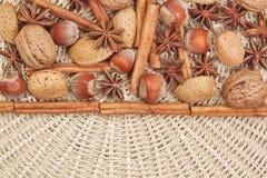 Framed For Christmas. Framed with cinnamon, star anise, walnuts, hazelnuts for Christmas stock photos