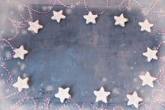 Framed christmas background. Cinnamon stars, snowflakes, snow royalty free stock image