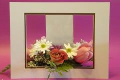 Framed floral arrangement. A flower arrangement framed with room for advertising stock images