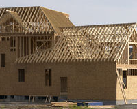 Framed house. Construction site stock images