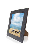 Framed Memories. Beach Scenic inside modern photo frame over white background Royalty Free Stock Images
