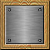 Framed metal plate. Shiny brushed metal plate in wooden frame Stock Image