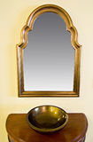 Framed mirror hanging on wall Royalty Free Stock Image