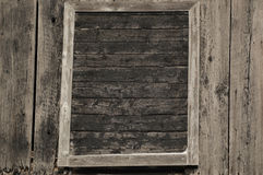 Framed old black door in the wall of an old farm building Royalty Free Stock Images