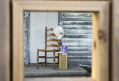 Framed old chair with suitcase Royalty Free Stock Photo