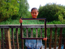 Framed Photo Manipulation Illusion. Taken at lake on bridge Royalty Free Stock Photography