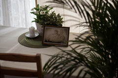 Framed picture of elderly couple. Standing on the table Stock Image