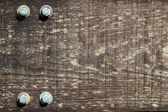 Framed piece of old wood with some bolts texture background Stock Images