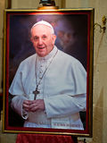 Pope Francis Portrait. Framed portrait of Pope Francis (Jorge Mario Bergoglio), Bishop of Rome and head of the Catholic Church, on display in a church
