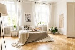 Free Framed Poster On A White Wall Above A Cozy Double Bed With Beige Stock Photography - 123627862