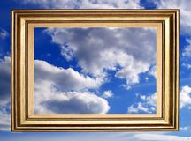 Framed sky. Golden frame over cloudy sky Royalty Free Stock Photos