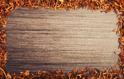 Framed with tobacco on wooden background Royalty Free Stock Images