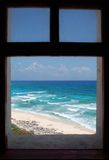 Framed View. Beautiful view through the lighthouse window to Punta Sur Eco Park beach on Cozumel island, Mexico Stock Photo