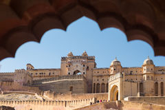 Framed view of the honey toned impressive Amber Fort, famous tourist attraction at Jaipur, Rajasthan, India. Daylight, clear blue Royalty Free Stock Image