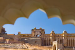 Framed view of the honey toned impressive Amber Fort, famous tourist attraction at Jaipur, Rajasthan, India. Daylight, clear blue Stock Image