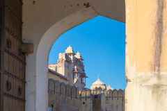 Framed view of the honey toned impressive Amber Fort, famous tourist attraction at Jaipur, Rajasthan, India. Daylight, clear blue Royalty Free Stock Photography