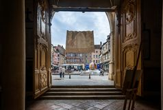 Framed view of Place Saint Vincent from inside the Cathedral in Chalon sur Saone, Burgundy, France. On 16 April 2016 stock photo